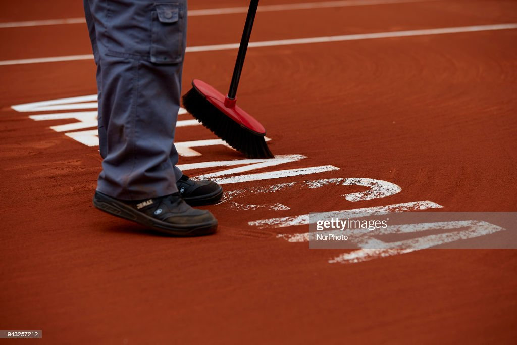 A staff member clean the Valencia inscription on the clay court during day two of the Davis Cup World Group Quarter Finals match between Spain and Germany at Plaza de Toros de Valencia on April 7, 2018 in Valencia, Spain