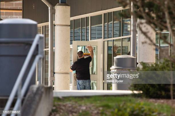 A staff member cleans a door at Bothell High School on February 27 2020 in Bothell Washington School district officials decided to close the school...