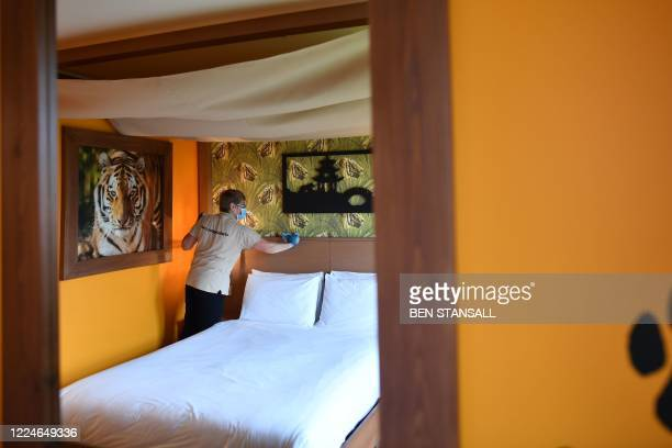 Staff member cleans a room in the hotel at Chessington World of Adventures Resort in chessington, Greater London on July 4 on the first day of a...