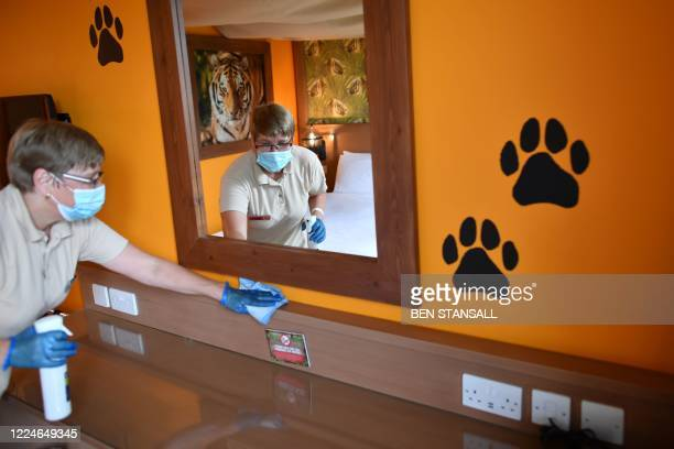 A staff member cleans a room in the hotel at Chessington World of Adventures Resort in chessington Greater London on July 4 on the first day of a...