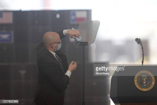 Staff member cleans the teleprompter before U.S. President Donald Trump arrives to deliver a speech at a Double Eagle Energy Holdings LLC oil rig in...