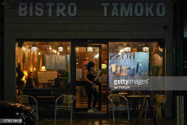A staff member collects empty glasses at a bistro on Linthorpe Road on October 02 2020 in Middlesbrough England The mayor of Middlesbrough Andy...