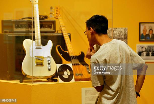 Staff member David Lien views the Rillera Brothers section at the rock n roll exhibit at the Fullerton Museum Center The Rillera Brothers were Santa...