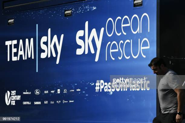 Staff member exits the bus of Great Britain's Team Sky cycling team on July 5, 2018 near Saint-Mars-la-Reorthe, western France, two days prior to the...
