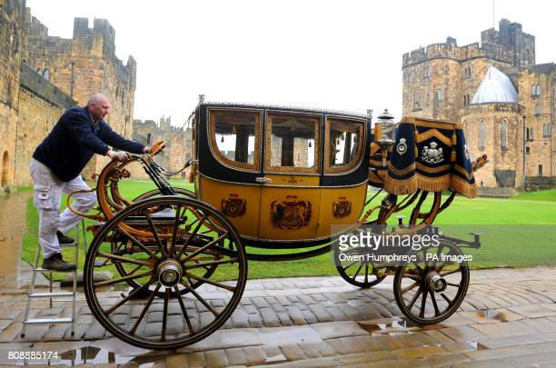 A staff member from the Alnwick Castle estate gets the 1825 Northumberland State Coach by ready for the wedding of the Duke and Duchesss of...