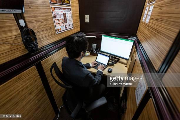 Staff member illustrates working at a coworking space at the hotel Anshin Oyado on December 17, 2020 in Tokyo, Japan. The hotel Anshin Oyado...