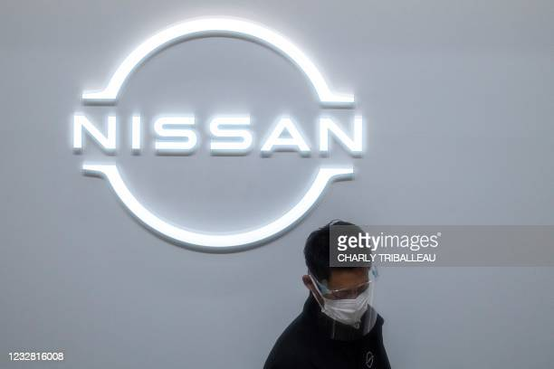 Staff member is pictured at the reception of the showroom at the Nissan Motor global headquarters in Yokohama, Kanagawa prefecture on May 11, 2021.