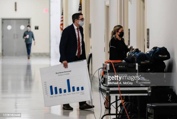 """Staff member is seen prior to a hearing before the House Oversight Committee in the Rayburn Building titled """"Protecting the Timely Delivery of Mail,..."""
