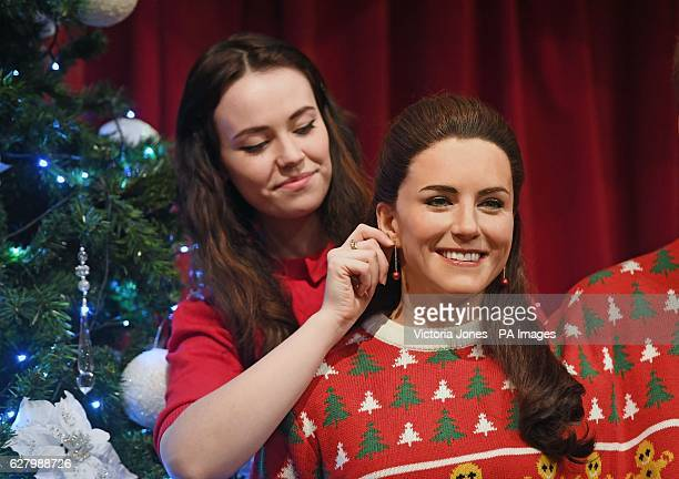 A staff member makes final adjustments to the wax figure of the Duchess of Cambridge wearing a Christmas jumper in Madame Tussauds London to raise...