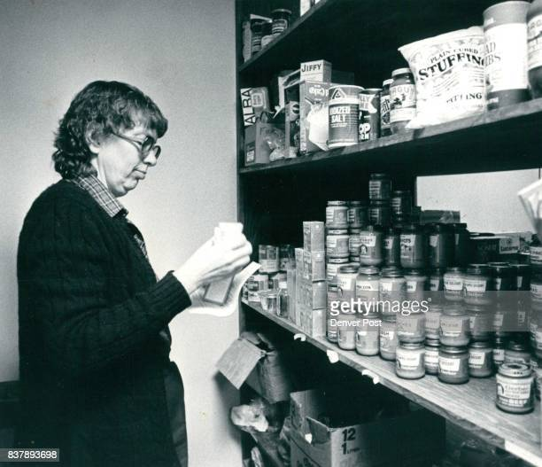 Staff member Marcia Stackhouse takes inventory of food supplies Credit Denver Post