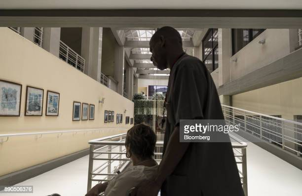 A staff member moves a patient in a wheelchair in the Oncology Unit of the Luis Razetti University Hospital in Barcelona Venezuela on Friday Aug 25...