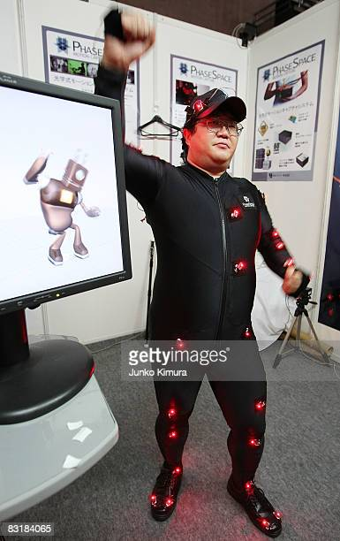 A staff member of Nihon Binary displays Phasespace's optical real time motion capture system during the Tokyo Game Show 2008 at Makuhari Messe on...