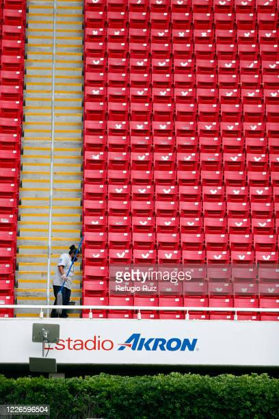 Staff member of the Akron Stadium cleans the stands before the match between Atlas and Tigres UANL as part of the friendship tournament Copa GNP por...