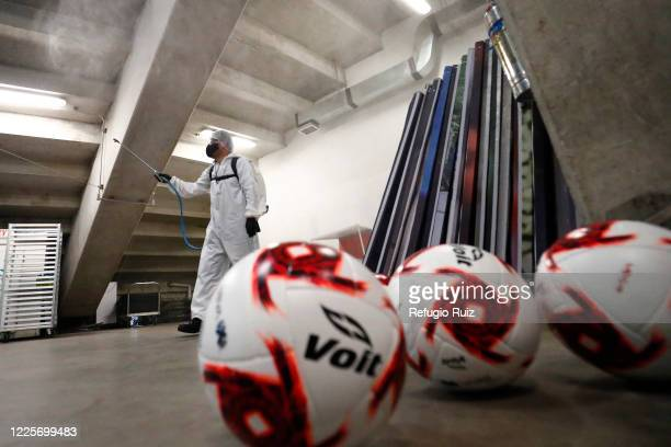A staff member of the Akron Stadium sanitizes before the match between Chivas and Tigres UANL as part of the friendly tournament Copa GNP por Mexico...