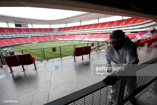 Staff member of the Akron Stadium sanitizes entrances before the match between Atlas and Mazatlan FC as part of the friendly tournament Copa GNP por...