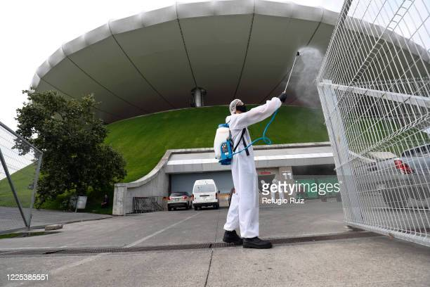 Staff member of the Akron Stadium sanitizesentrances before the match between Atlas and Mazatlan FC as part of the friendly tournament Copa GNP por...