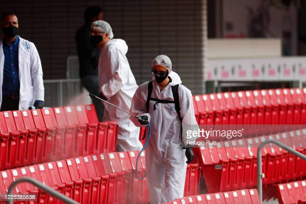 Staff member of the Akron Stadium sanitizesthe stands before the match between Atlas and Mazatlan FC as part of the friendly tournament Copa GNP por...