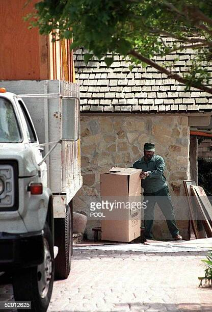 A staff member of the Bekins moving company hired by the Los Angeles County Sheriffs Department loads a truck with former football star OJ Simpson's...
