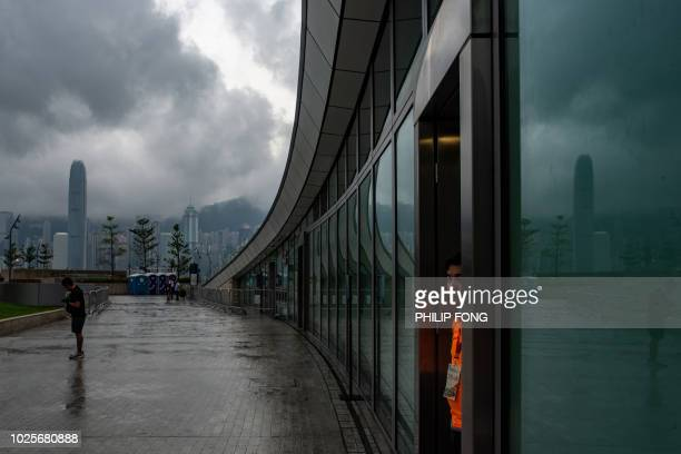 A staff member of the Mass Transit Railway stands at the 'Green Plaza' of the West Kowloon terminus in Hong Kong during an open day to the public on...