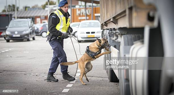 A staff member of the Mobile Surveillance Security of the Royal Military Marechaussee the Dutch national police forces controls a truck during an...