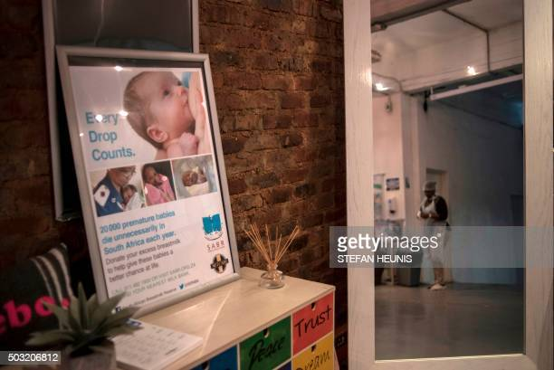 A staff member of the South African Breastmilk Reserve in Johannesburg gets ready to go into the sterilised Milk Kitchen on November 24 2015 in...