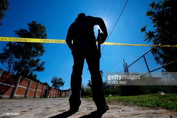TOPSHOT A staff member of the Specialized Prosecutor's Office for Missing Persons works at El Mirador neighborhood in Tlajomulco de Zuniga state of...
