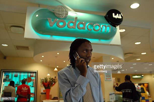 A staff member of Vodacom South Africa's largest cellular telephone provider makes a call on a cellphone at Vodacom's head office in Johannesburg...