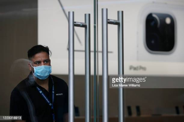 Staff member prepares to open the doors to customers at the Bondi Junction Apple Store on May 07, 2020 in Sydney, Australia. Apple stores across...