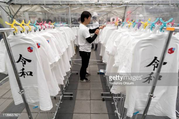 A staff member prepares tshirts featuring the name of Japan's next imperial era 'Reiwa' during an event hosted by Mercari Inc in the Shibuya district...