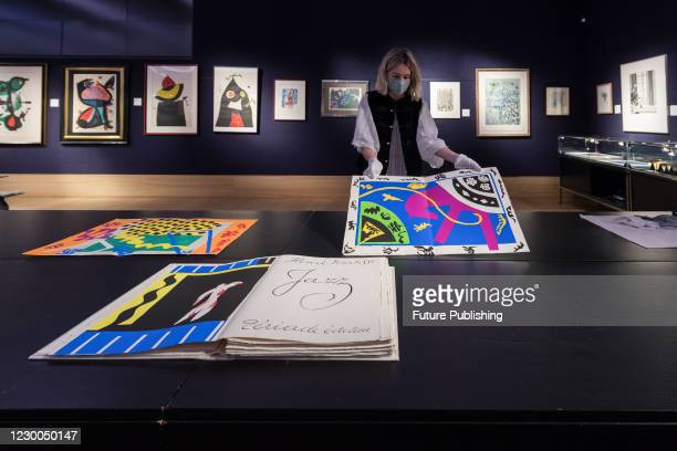 Staff member presents a book by Henri Matisse Jazz, Tériade, Paris, 1947 the set of 20 pochoirs in colours during a photo call for Bonhams' Prints &...