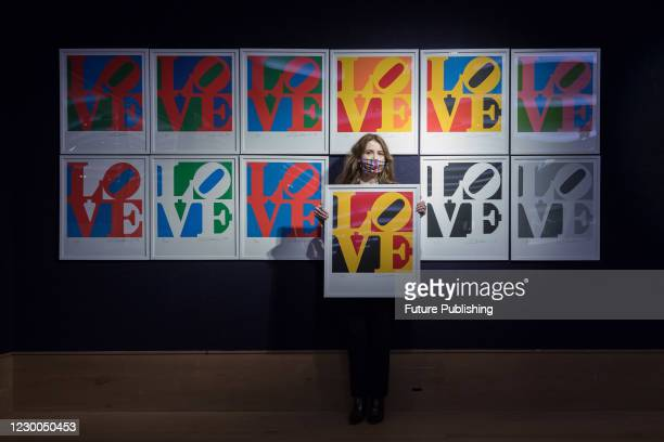 Staff member presents Robert Indiana's The Book of Love, 1996 during a photo call for Bonhams' Prints & Multiples Sale, on December 10, 2020 in...