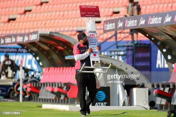 A staff member puts on a sanitizing station prior the 6th round match between Atletico San Luis and Cruz Azul as part of the Torneo Guard1anes 2020...