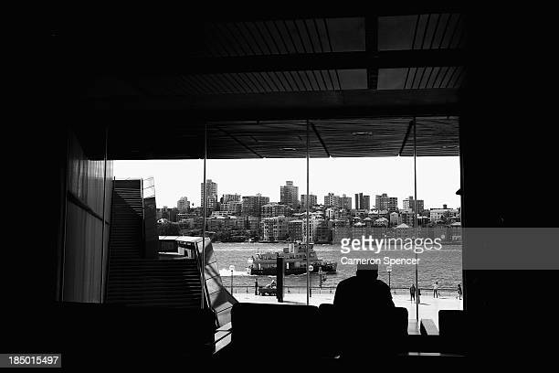 A staff member relaxes in the green room looking out at Sydney Harbour from inside the Sydney Opera House on September 20 2013 in Sydney Australia On...