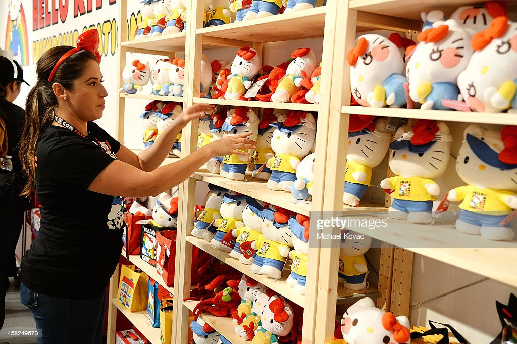A staff member replenishes products inside the Hello Kitty Friendship Station at Hello Kitty Con 2014 at The Geffen Contemporary at MOCA on November 1, 2014 in Los Angeles, California.