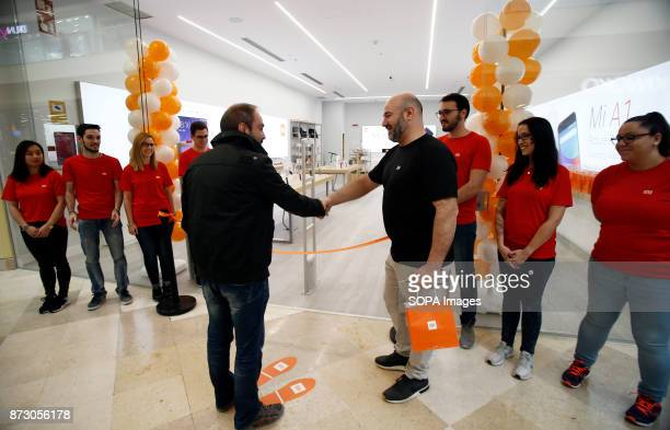 XANADú ARROYOMOLINOS MADRID SPAIN A staff member seen shaking hand with the the first customer The company Xiaomi inaugurates its first store in...