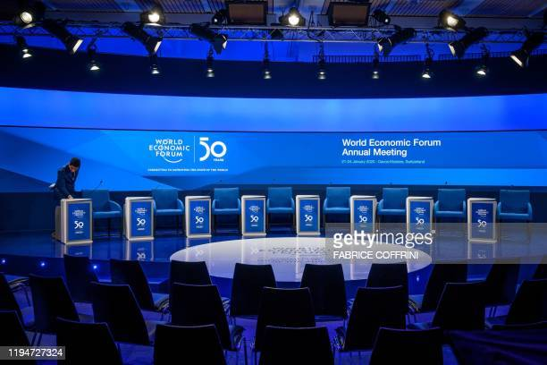 A staff member sets up a conference room at the Congress center ahead of the annual meeting of the World Economic Forum in Davos on January 19 2020