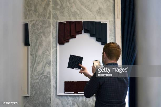 Staff member speaks during a video call as new members of Congress choose their office decor in Rayburn House Office Building in Washington, D.C.,...
