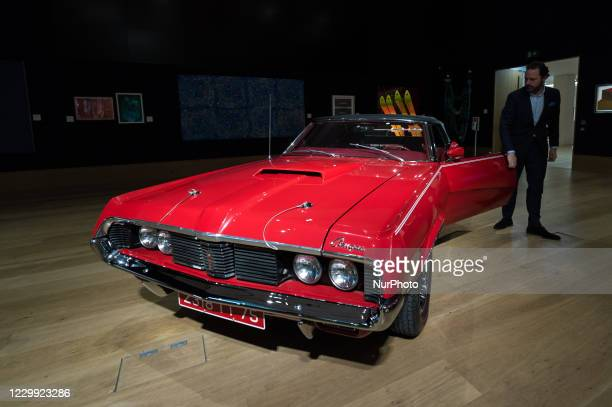 Staff member steps out of a 1969 Mercury Cougar XR7 convertible , which had a starring role in the classic Bond film 'On Her Majestys Secret Service'...