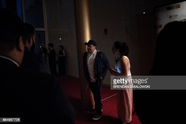 A staff member turns a kitchen worker away from the red carpet before VIPs arrive for the 40th Kennedy Center Honors December 3 2017 in Washington DC...