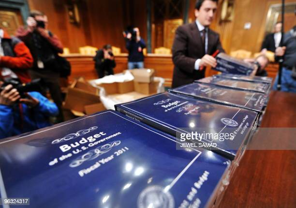A staff member unpacks copies of US President Obama's FY2011 Budget at the Dirksen Senate Office Building in Washington DC on February 1 2010 Obama's...