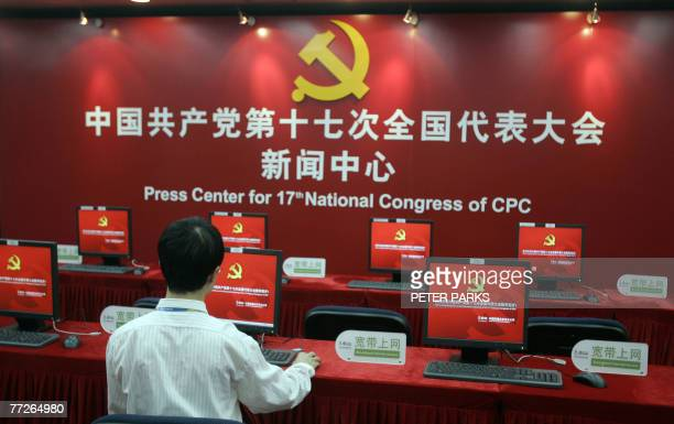 Staff member uses a computer at the press centre for the 17th National Congress of the Communist Party of China in Beijing, 11 October 2007. Prime...