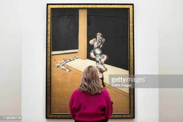 A staff member views Francis Bacon's painting titled Turning Figure at the preview of Sotheby's Contemporary Art The auction will take place at...
