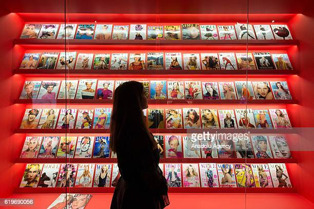 Staff member views over 100 Vogue fashion magazine covers featuring the work of Sam McKnight on November 01 2016 in London England