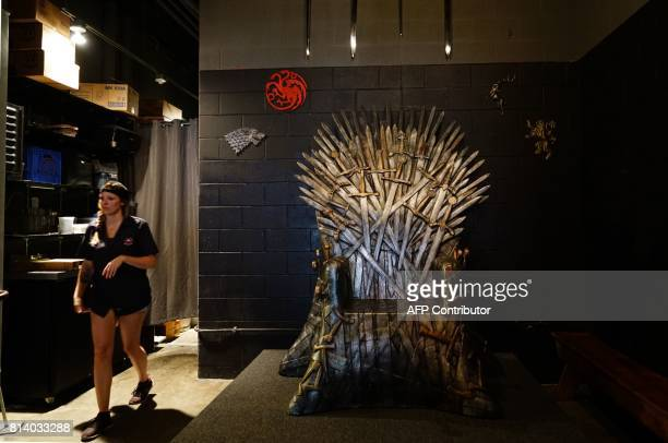 A staff member walks past the Iron Throne before patrons arrive at the Game of Thrones popup bar in Washington DC on July 12 2017 As Game of Thrones...