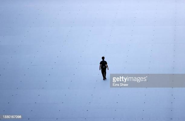 Staff member walks the floor prior to the Opening Ceremony of the Tokyo 2020 Olympic Games at Olympic Stadium on July 23, 2021 in Tokyo, Japan.