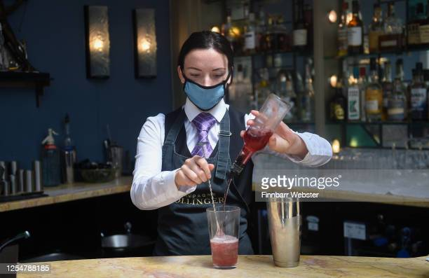 Staff member wearing protective face mask makes a cocktail on July 07, 2020 in Bigbury-on-Sea, United Kingdom. The Art Deco Burgh Island Hotel is...