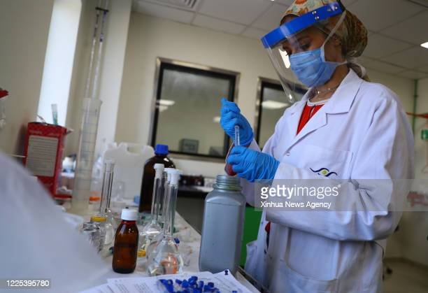 Staff member works in a lab of Eva Pharma drugmaker in Giza Province, Egypt, on July 2, 2020. TO GO WITH Feature: Egyptian pharmaceutical firm...