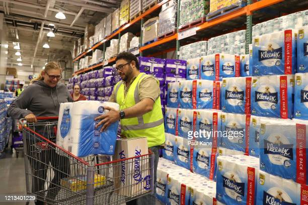 Staff members assist shoppers at Costco Perth on March 19 2020 in Perth Australia The store which is the first Costco in Western Australia is...