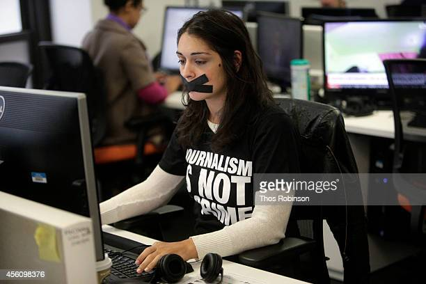 Staff members at Al Jazeera America attend 'Journalism Is Not A Crime' a campaign calling for the release of journalists imprisomed in Egypt at Al...