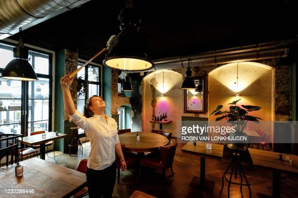 Staff members cleans during preparations at Cafe Ubica, which has taken several precautions ahead of its temporary Fieldlab reopening in Utrecht on...